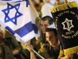 Israeli army soldiers dance with Torah scrolls during the celebration of Simhat Torah PHOTO: REUTERS
