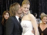 "Singer Keith Urban (L) kisses his wife Nicole Kidman, nominated for best actress in a leading role for ""Rabbit Hole"". PHOTO: REUTERS"