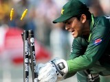 Kamran Akmal runs out Australian batsman Cameron White during the Cricket World Cup match between Australia and Pakistan. PHOTO: AFP