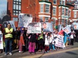 Protesters holding banners in Manchester. PHOTO: ORGANISERS