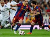 Barcelona's midfielder Xavi Hernandez (C)  vies for the ball with Real Madrid's Portuguese defender Pepe during the 'El Clasico' Spanish League football match Real Madrid against Barcelona at the Santiago Bernabeu stadium in Madrid, on April 16, 2011. PHOTO: AFP
