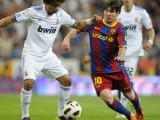 Marcelo (L) fights for the ball with Barcelona's Lionel Messi at Santiago Bernabeu stadium in Madrid PHOTO: AFP