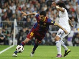 """Barcelona's midfielder Andres Iniesta (L) vies with Real Madrid's Brazilian defender Marcelo (R) during """"El Clasico"""" Spanish League football match Real Madrid against Barcelona at the Santiago Bernabeu stadium in Madrid, on April 16, 2011. PHOTO: AFP"""