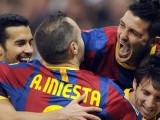 Barcelona's soccer players celebrate after scoring during  El clasico  Spanish League football match Real Madrid against Barcelona at the Santiago Bernabeu stadium in Madrid, on April 16, 2011. PHOTO: AFP