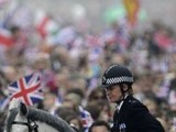 Mounted police control the crowd as they walk along the Processional Route to Buckingham Palace following the wedding of Prince William to Kate Middleton in London on April 29, 2011. PHOTO: AFP