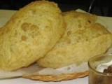 Soft puris with warm sweet halwa and salty chanas are delicious