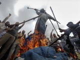 Supporters of MQM burn an effigy representing Zulfikar Mirza during a protest in Karachi July 14, 2011. PHOTO: REUTERS