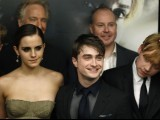 "Cast members Rupert Grint (R), Daniel Radcliffe and Emma Watson (L) arrive for the premiere of the film ""Harry Potter and the Deathly Hallows: Part 2"" in New York. PHOTO: REUTERS"