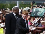 "Cast member Rupert Grint signs autographs as he arrives for the premiere of the film ""Harry Potter and the Deathly Hallows: Part 2"" PHOTO: REUTERS"