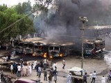 Busses are set on fire during a fresh wave of violence in the port city of Karachi on July 14, 2011. PHOTO: AFP