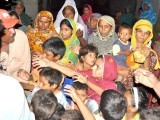 The flood ravaged families of Badin reach out desperately for relief goods. PHOTO: YOUSUF NAGORI