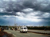 Clouds signal the oncoming of heavy rain showers in Karachi. PHOTO: SHAHID ALI/EXPRESS