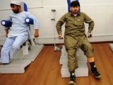 Disabled military veterans at Pakistan's Armed Forces Institute of Rehabilitation Medicine (AFIRM) perform exercises in Rawalpindi.  PHOTO: AFP