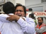 A man mourns the death of a relative after a car bomb blast in Karachi on September 19, 2011. PHOTO: REUTERS