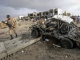 A paramilitary soldier walks past the site of a suicide bomb attack in Karachi on September 19, 2011. PHOTO: REUTERS