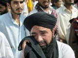 A supporter of Malik Mumtaz Hussain Qadri, weeps after the court announced the death sentence for Qadri, outside Adiyala Prison in Rawalpindi on October 1, 2011. PHOTO: AFP