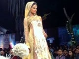A model poses at bridal couture week 2011. PHOTO: MARIA UMAR