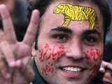 A supporter of Pakistan Muslim League-N (PML-N) flashes the victory sign during a rally against Pakistan's President Asif Ali Zardari in Lahore on October 28, 2011. PHOTO: AFP