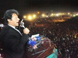 Imran Khan addressing the crowd at the PTI rally yesterday. PHOTO: AFP