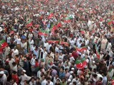 The PTI rally on Sunday attracted large masses from the lower, middle and upper class in Lahore. PHOTO: AFP