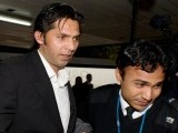 Former Pakistani cricketer Mohammad Asif (L) arrives at Southwark Crown Court in London, on November 3, 2011. Asif was jailed for 12 months Thursday for his part in the fixing of a Test match against England in 2010. PHOTO: AFP