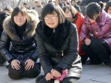 Residents react as they mourn over the death of Kim Jon-il. PHOTO: REUTERS