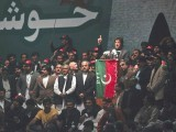 He was straddled on stage by new entrants and political heavyweights Shah Mahmood Qureshi and Javed Hashmi. PHOTO: REUTERS