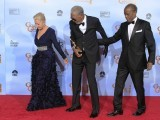 Actor Morgan Freeman (C), recipient of the Cecille B. DeMille award, poses with presenters Hellen Mirren (L) and Sidney Portier backstage at the 69th annual Golden Globe Awards in Beverly Hills, California, January 15, 2012. PHOTO: REUTERS