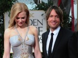 1996, 2002 and 2003 Golden Globe winner; 1992, 2002, 2004, 2005 and 2011 Golden Globe nominee Nicole Kidman arrives with husband Keith Urban on the red carpet for the 69th annual Golden Globe Awards at the Beverly Hilton Hotel in Beverly Hills, California, January 15, 2012. PHOTO: AFP