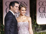 Actress Jessica Alba and husband Cash Warren arrive at the 69th annual Golden Globe Awards in Beverly Hills, California