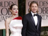 Actors Angelina Jolie and Brad Pitt pose for photographers as they arrive at the 69th annual Golden Globe Awards in Beverly Hills, California January 15, 2012.   PHOTO: REUTERS