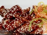 Fried beef strips with sesame seed and honey hoisin sauce.