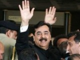 Gilani was waving his unrestrained hands and ushered into safety by his colleagues. PHOTO: MUHAMMAD JAVED / EXPRESS