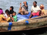Myanmar's Muslim Rohingya people are on a boat cross the river Naf, from Myanmar into Bangladesh, in Teknaf. PHOTO: REUTERS