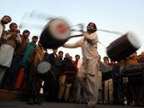 The dholaks, and the dance ─ sufism seeps pure and chaste through the city. PHOTO: AFP