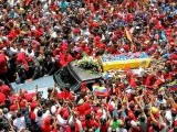 The coffin of Venezuelas late president Hugo Chavez is driven through the streets of Caracas. PHOTO: REUTERS
