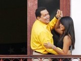 Venezuelan President Hugo Chavez dances with his granddaughter Gabriela on a balcony as he celebrates his 57th birthday in Caracas on July 28. PHOTO: REUTERS