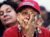 A supporter mourns the death of President Hugo Chavez. PHOTO: AFP