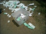 'Karachi NA250 unprecedented rigging. Sealed ballot boxes opened and thrown out.' PHOTO: MUHAMMAD IRFAN BHUNDI