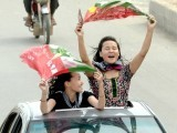 Supporters of PTI wave flags in Rawalpindi. PHOTO: AFP