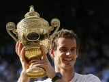 Andy Murray lifts the cup. PHOTO: REUTERS