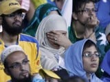 A Pakistani cricket team fan's reaction after the team loses the match. PHOTO: REUTERS