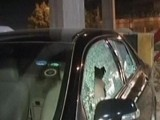 Cars parked outside the Express Media Office were severely damaged. PHOTO: Screengrab from Express News