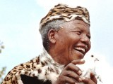President Nelson Mandela, wearing leopard skin traditional clothes, releases a white dove for peace at a rally to commemorate the 34th anniversary of the massacre of 69 black demonstrators by the police, 21 March 1994, in Sharpville, south of Johannesburg. PHOTO: AFP