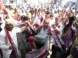 Sindhi topis and ajraks might have all the pomp and spectacle of days of the past. It is the present which is haunting and the future which remains perilous. PHOTO: SHAHID ALI/EXPRESS