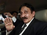 Pakistan's deposed chief justice Iftikhar Chaudhry waves to supporters at Jinnah International airport in Karachi October 18, 2008, as he arrives to attend a lawyers convention in Hyderabad. PHOTO: REUTERS