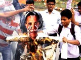 ABVP activists burn an effigy of US President, Barack Obama during a protest against Devyani Khobragade's arrest. PHOTO: REUTERS