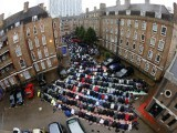 Muslims attend Friday prayers on a rainy first day of Ramadan, at the courtyard of a housing estate next to a small BBC community centre and mosque in east London. PHOTO: REUTERS