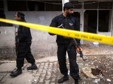 A policeman cordons off the site of a bomb attack at the district court in Islamabad. PHOTO: REUTERS