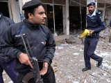 Policemen inspect a local court building after a gun and bomb attack in Islamabad on March 3. PHOTO: AFP